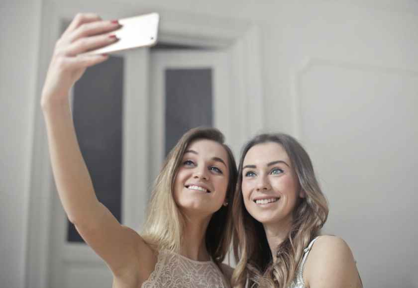 photo of women taking picture